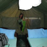 Filmmaker Jordan Salvatoriello enters her tent in the Maasai Mara.