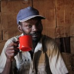Zipporah's father drinks tea at his home in Maragima.