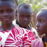 Zipporah's younger siblings outside their home in Maragima, Kenya.